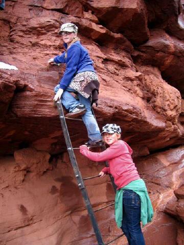 Bri and Sierra climbing the ladder